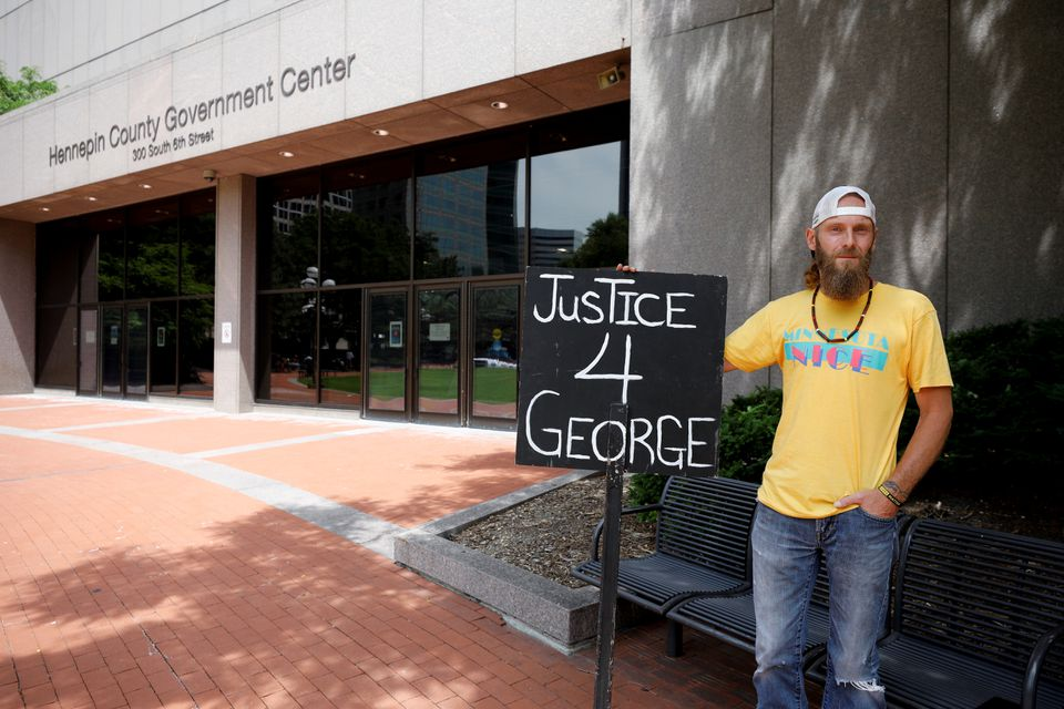 Brandon Pomerleau poses for a picture outside Hennepin County Government Center ahead of a sentence being pronounced on former police officer Derek Chauvin who was convicted last month for murdering George Floyd, in Minneapolis, Minnesota, U.S., June 25, 2021. REUTERS/Nicholas Pfosi