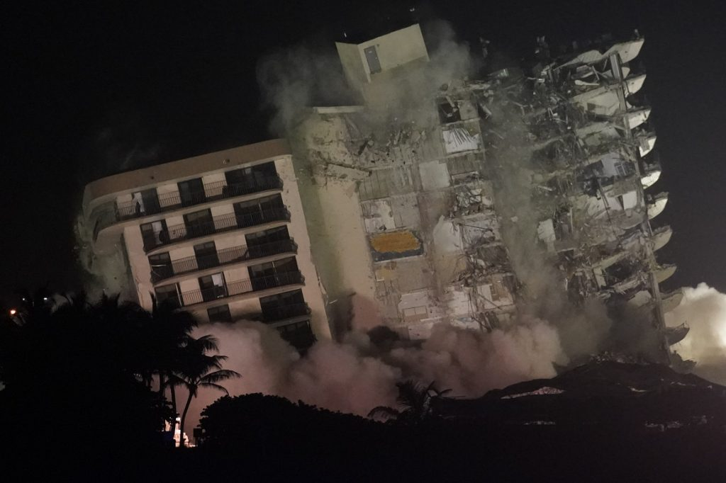 Collapsed Florida condo demolished ahead of storm, search to resume